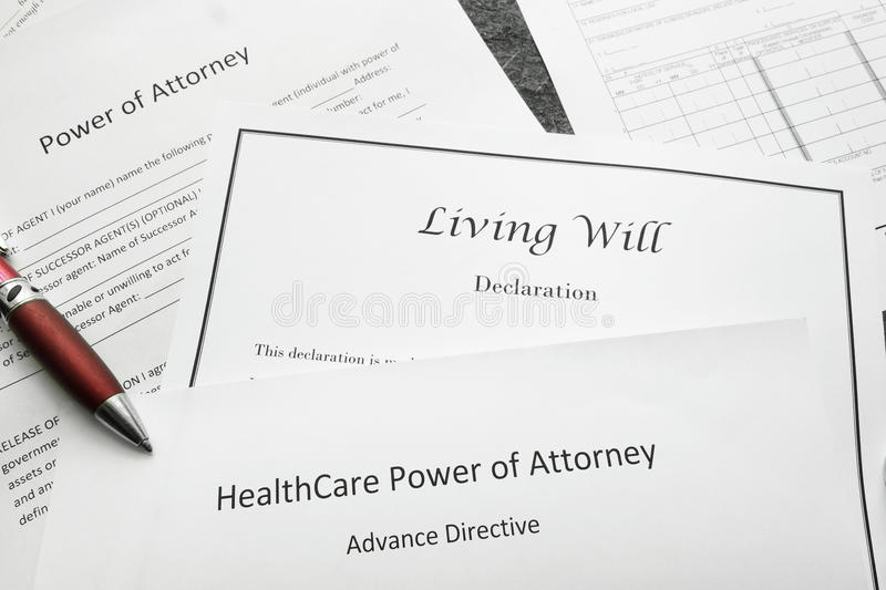 Legal and estate planning. Power of Attorney, Living Will, and Healthcare Power of Attorney documents royalty free stock photo