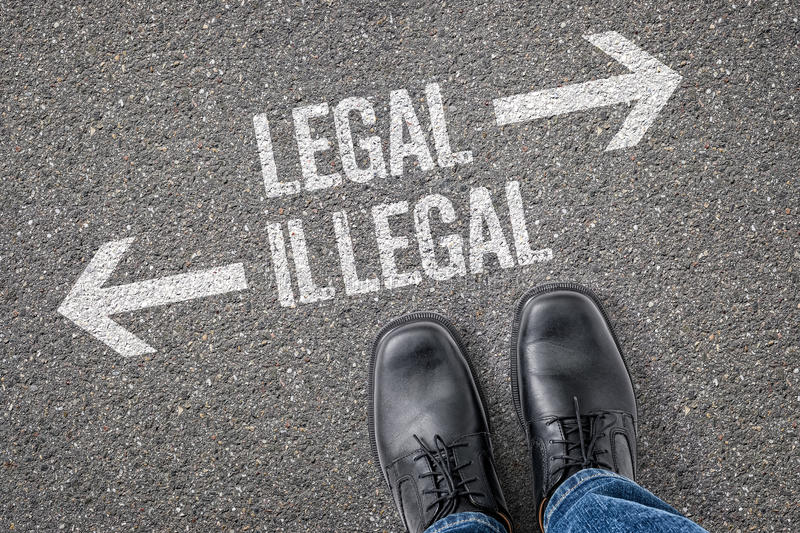Legal or Illegal. Decision at a crossroad - Legal or Illegal royalty free stock photos