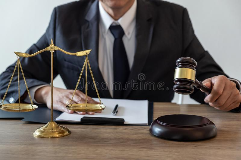Legal law, advice and justice concept, counselor lawyer or notary working on a documents and report of the important case and. Wooden gavel, brass scale on stock image