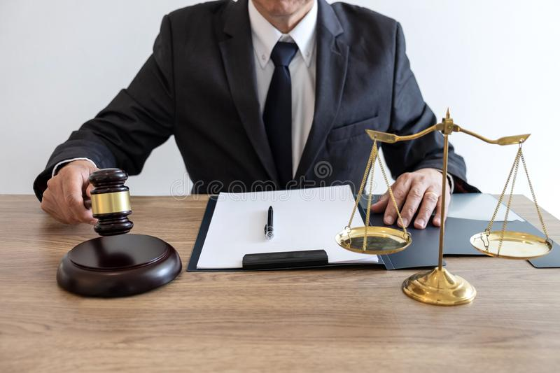 Legal law, advice and justice concept, counselor lawyer or notary working on a documents and report of the important case and. Wooden gavel, brass scale on stock images