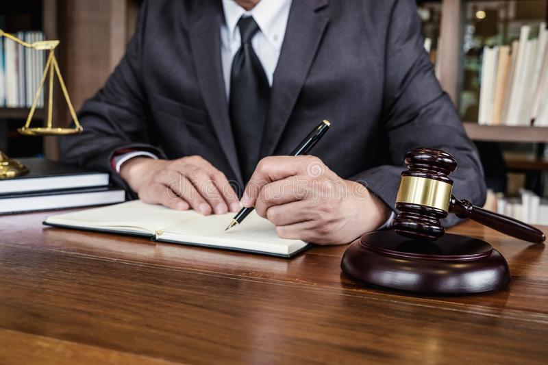 Legal law, advice and justice concept, Judge gavel with Justice lawyers, Counselor in suit or lawyer working on a documents in. Courtroom stock image