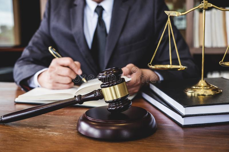 Legal law, advice and justice concept, Judge gavel with Justice. Lawyers, Counselor in suit or lawyer working on a documents in courtroom stock photo