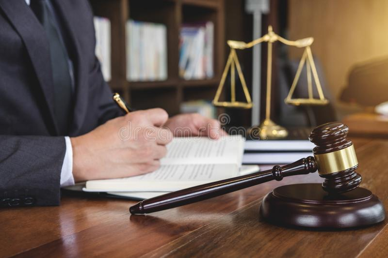 Legal law, advice and justice concept, Judge gavel with Justice. Lawyers, Counselor in suit or lawyer working on a documents in courtroom royalty free stock photography