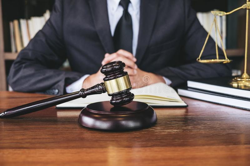 Legal law, advice and justice concept, Judge gavel with Justice. Lawyers, Counselor in suit or lawyer working on a documents in courtroom royalty free stock photo