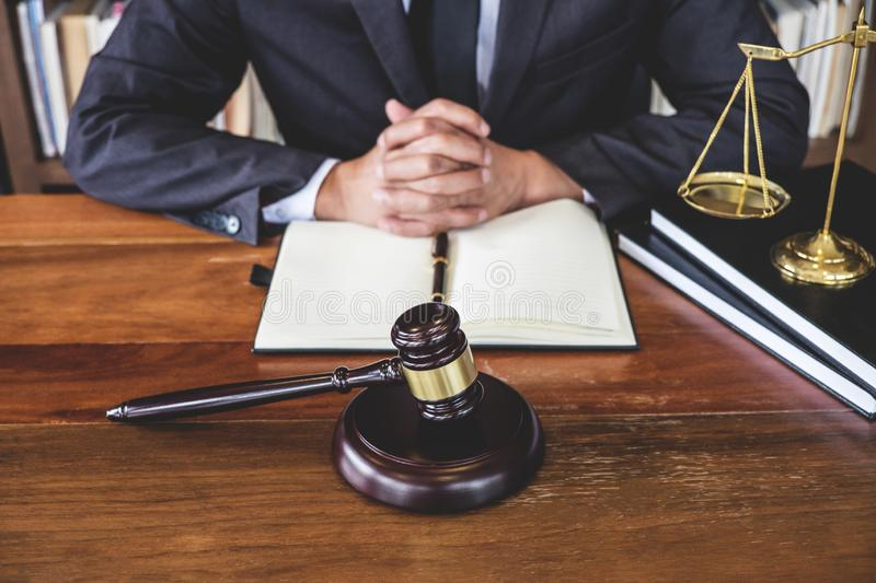 Legal law, advice and justice concept, Judge gavel with Justice. Lawyers, Counselor in suit or lawyer working on a documents in courtroom stock photos