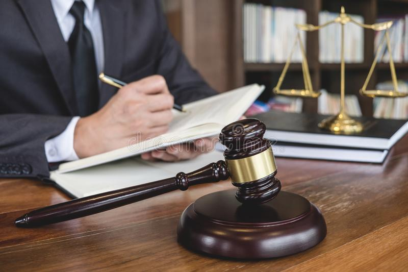Legal law, advice and justice concept, Judge gavel with Justice lawyers, Counselor in suit or lawyer working on a documents in. Courtroom stock photos