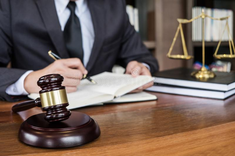 Legal law, advice and justice concept, Judge gavel with Justice lawyers, Counselor in suit or lawyer working on a documents in. Courtroom stock images