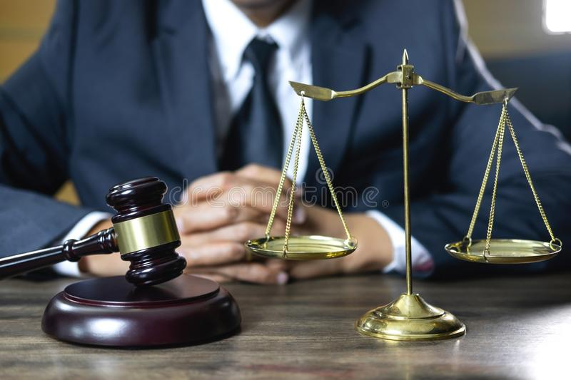 Legal law, advice and justice concept, male counseling lawyer or. Notary working on a documents and contract papers of the important case and wooden gavel royalty free stock photos