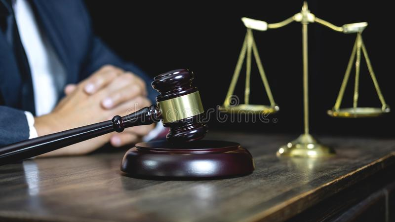 Legal law, advice and justice concept, male counseling lawyer or. Notary working on a documents and contract papers of the important case and wooden gavel stock images