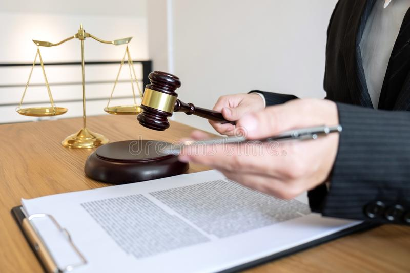 Legal law, advice and justice concept, male lawyer or notary working on a documents and report of the important case and wooden g. Avel, balance on table in stock images