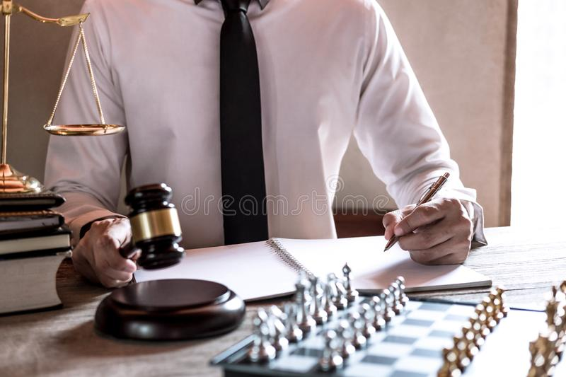 Legal law, advice and justice concept, Professional male lawyers working on courtroom sitting at the table and signing papers with stock photos