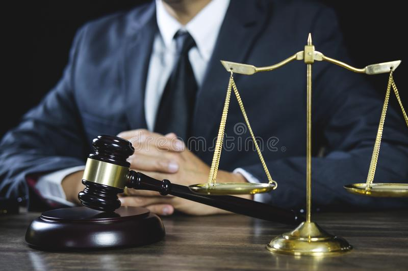 Legal law, Judge gavel with Justice lawyers advice with gavel and Scales of justice, Counselor or Male lawyer working on courtroom. Sitting at the table and royalty free stock photography