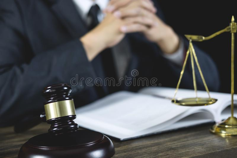 Legal law, Judge gavel with Justice lawyers advice with gavel and Scales of justice, Counselor or Male lawyer working on courtroom. Sitting at the table and royalty free stock photo