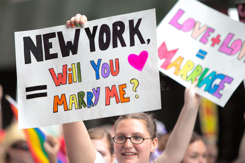 Legal marriage-Pride Parade NYC 2011. Girl is holding Sign with Will You Marry Me, after a day legalize same-sex marriage in New York - Pride Parade in New York royalty free stock image