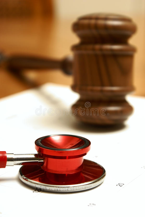 Legal and Medical. Medical and legal systems come together in this still life royalty free stock photography
