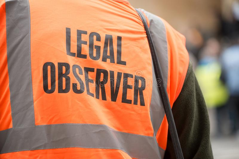 Legal observer at the Britain Is Broken / General Election Now demonstration in London. stock image