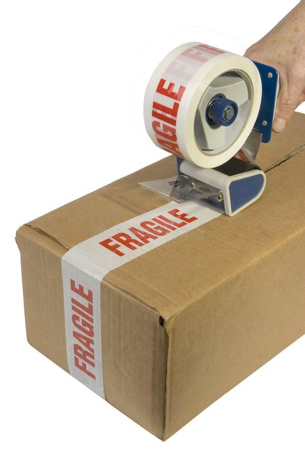 Legare una casella con un nastro fotografia stock libera da diritti