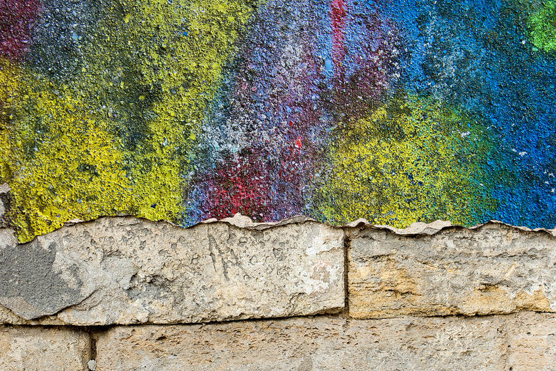 Lege achtergrond voor uw tekst De textuur van een grunge oude straat op de voorgevelmuur met gebarsten verf stock foto