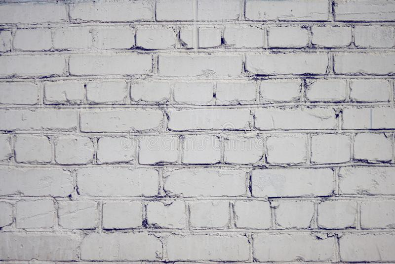 Lege die achtergrond met baksteenoppervlakte, met witte verf wordt geschilderd stock afbeeldingen