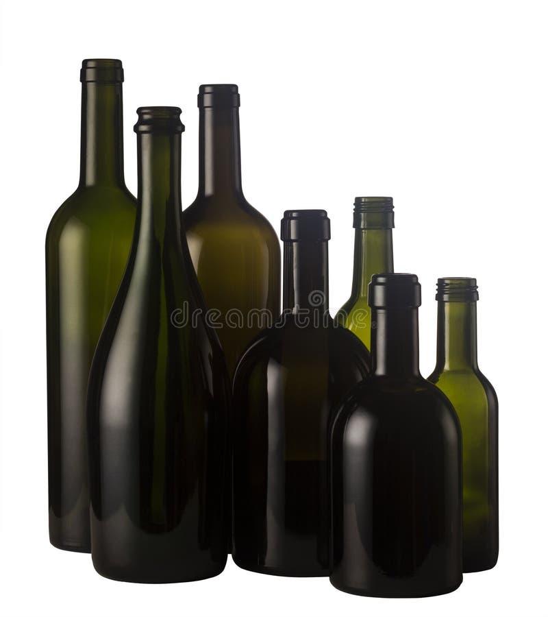 Lege die wijnflessen op wit worden geïsoleerd royalty-vrije stock foto's