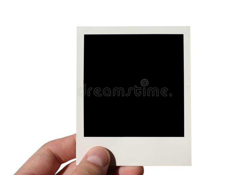 Lege geïsoleerden polaroid van de holding - stock afbeelding