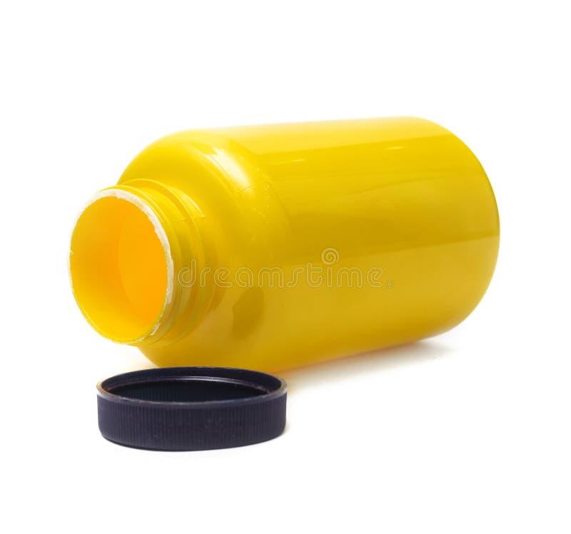 Lege gele fles Sportenvoeding stock foto