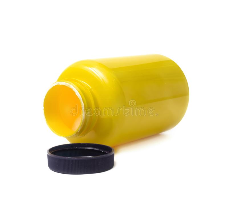 Lege gele fles Sportenvoeding stock afbeelding