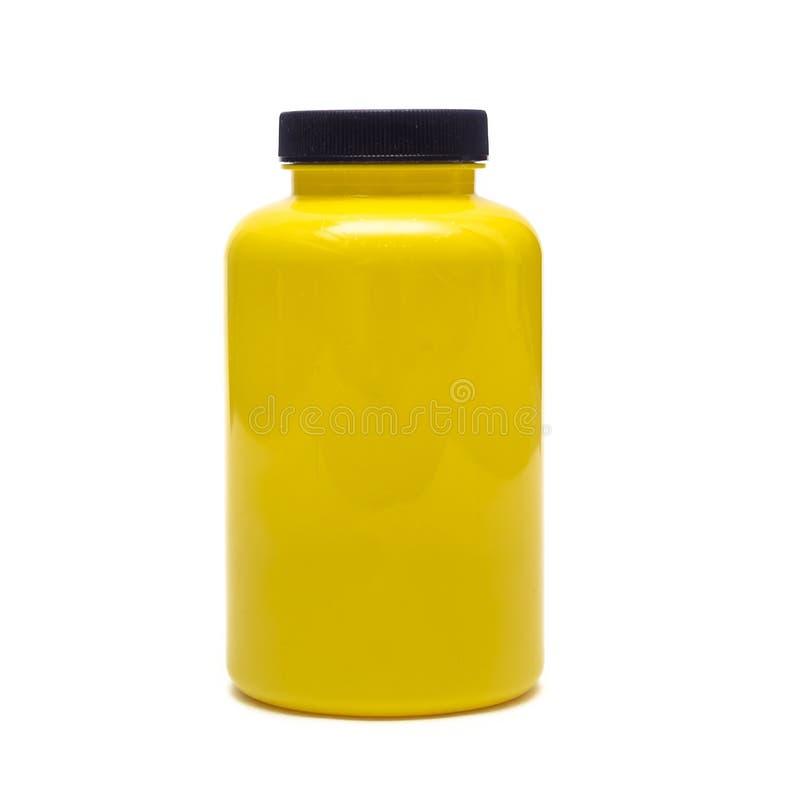 Lege gele fles Sportenvoeding stock afbeeldingen