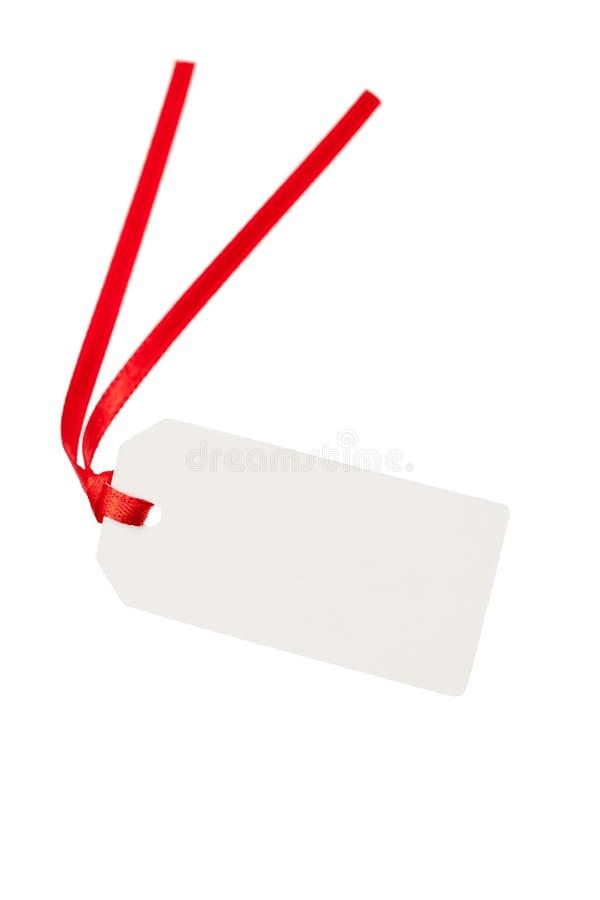 Lege giftmarkering met rood lint stock afbeeldingen