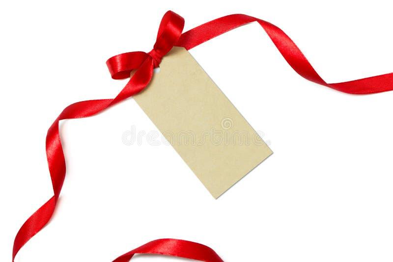 Lege giftmarkering met rood lint royalty-vrije stock fotografie