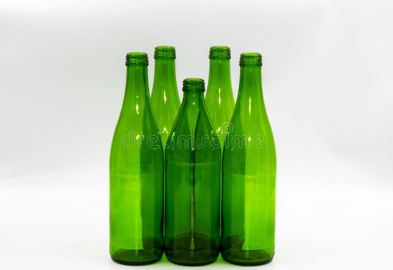 Lege glasflessen op een witte achtergrond stock foto