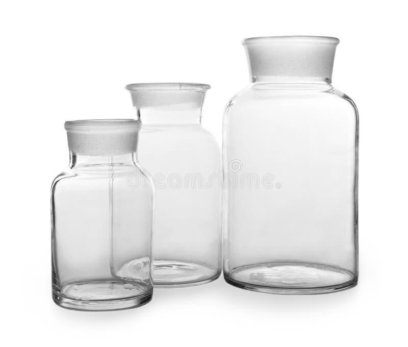 Lege glasflessen op witte achtergrond royalty-vrije stock afbeelding
