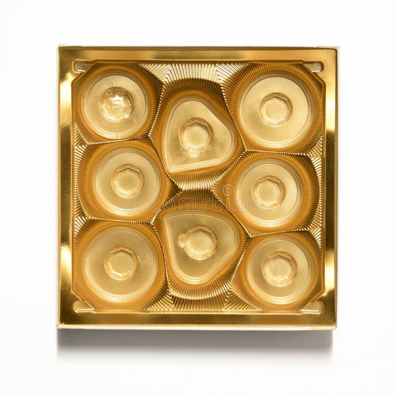 Lege gouden chocoladedoos - plastic chocoladecontainer royalty-vrije stock afbeeldingen