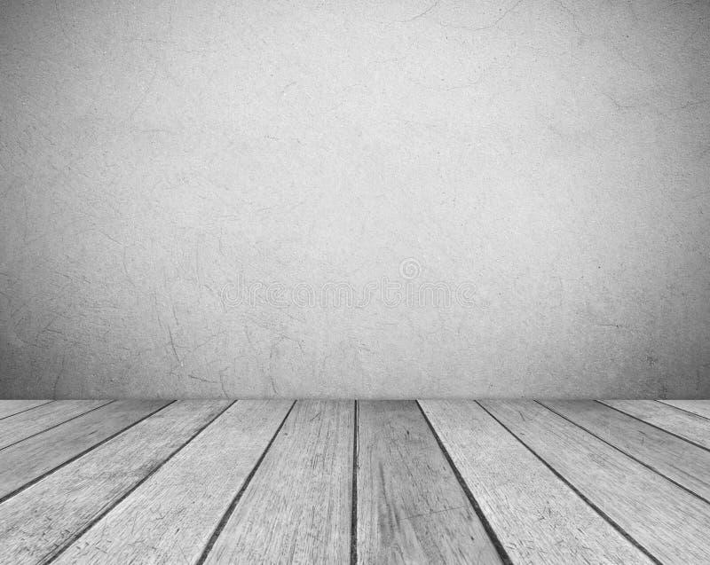 Lege grijze cementmuur en uitstekende houten vloerruimte in perspectiefmening, grunge achtergrond, binnenlands ontwerp, productve royalty-vrije stock afbeelding