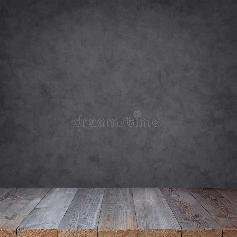 Lege houten lijst tegen een grijze muur stock afbeelding
