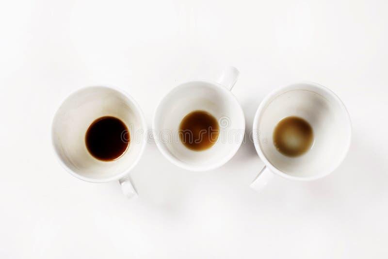 Lege koffiekoppen op witte achtergrond royalty-vrije stock foto