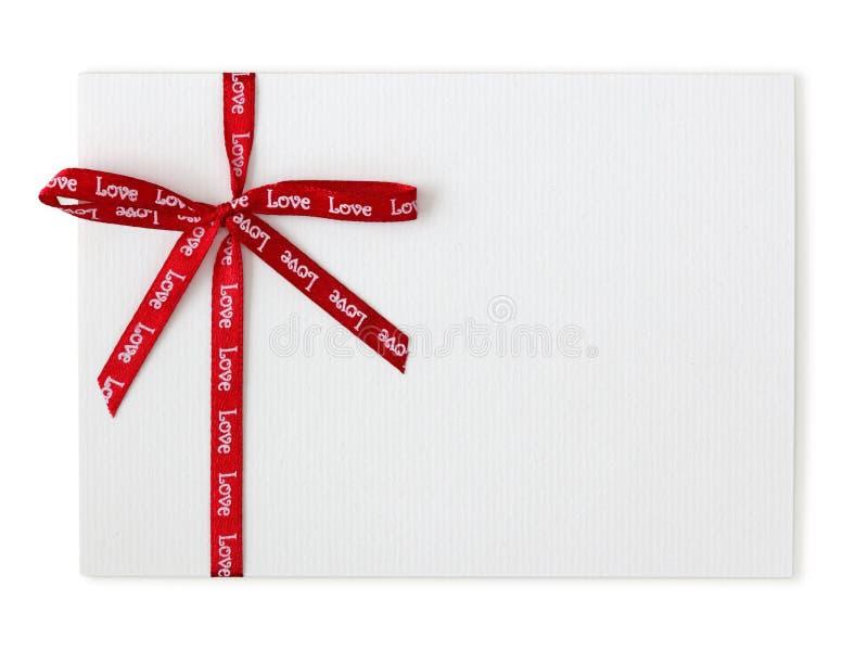Lege nota en rood lint stock fotografie