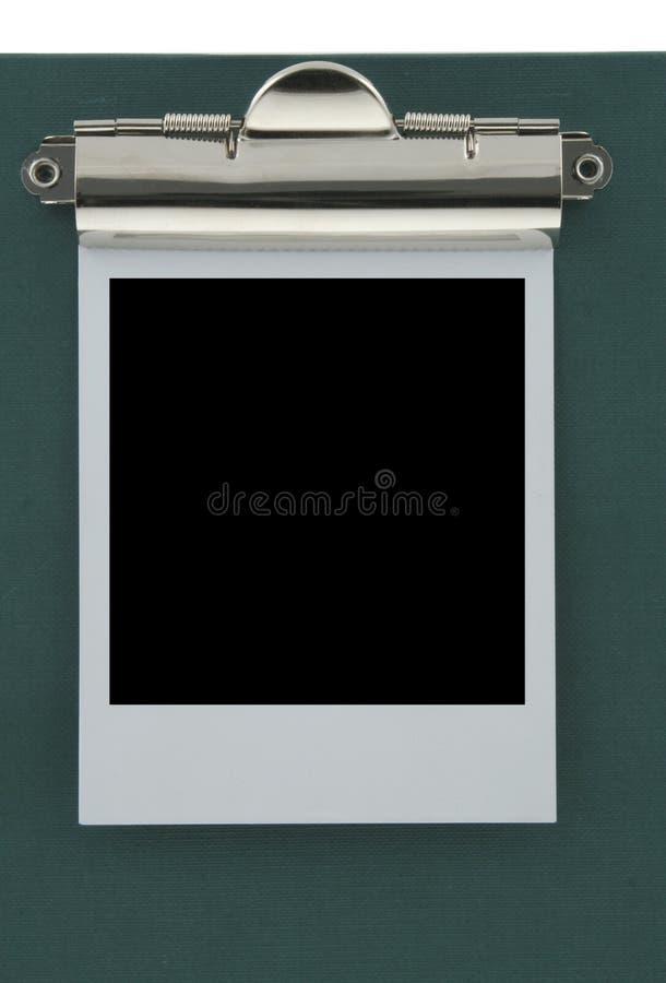 Lege polaroid die aan een klembord wordt geplakt royalty-vrije stock foto