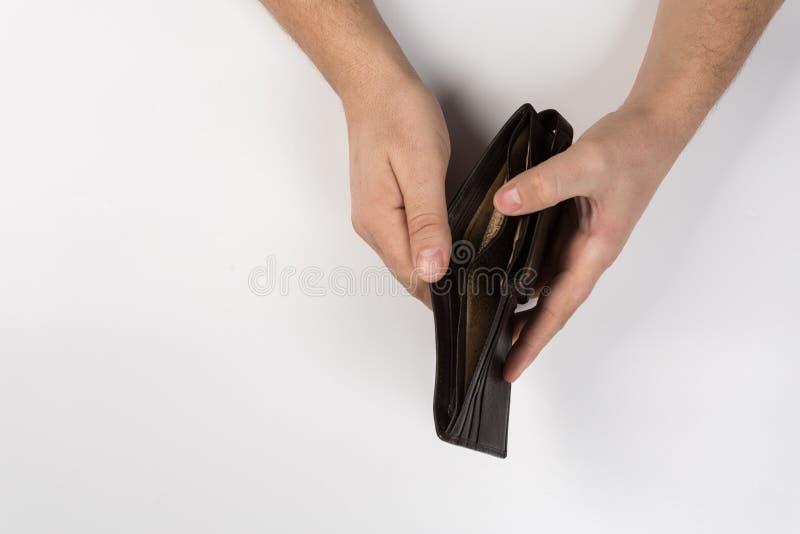 Lege portefeuille in zijn handen royalty-vrije stock afbeeldingen