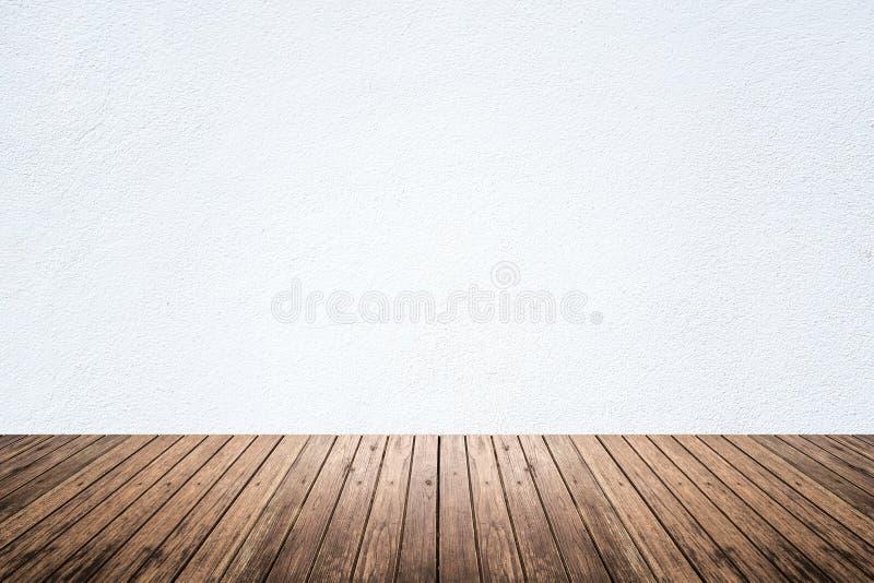 Lege ruimte van witte muur en houten vloer royalty-vrije stock afbeeldingen