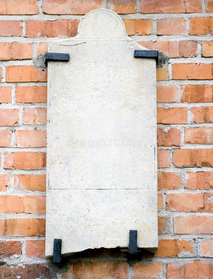 Lege steenplak op muur stock afbeeldingen