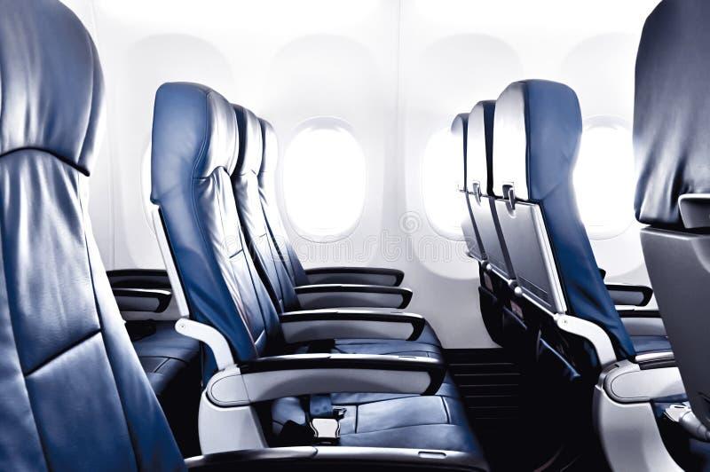 Lege vliegtuigzetels - economie of tweede klas stock foto's