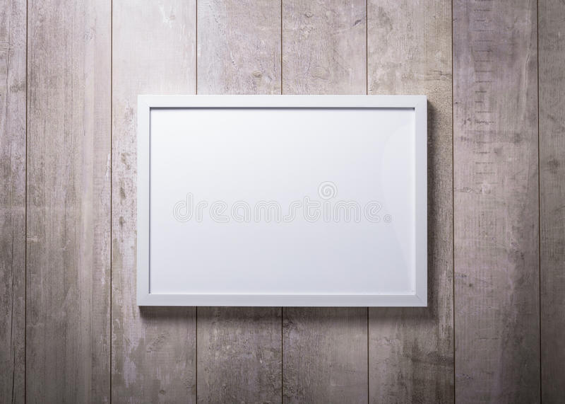 Lege witte omlijsting op de houten muur royalty-vrije stock foto