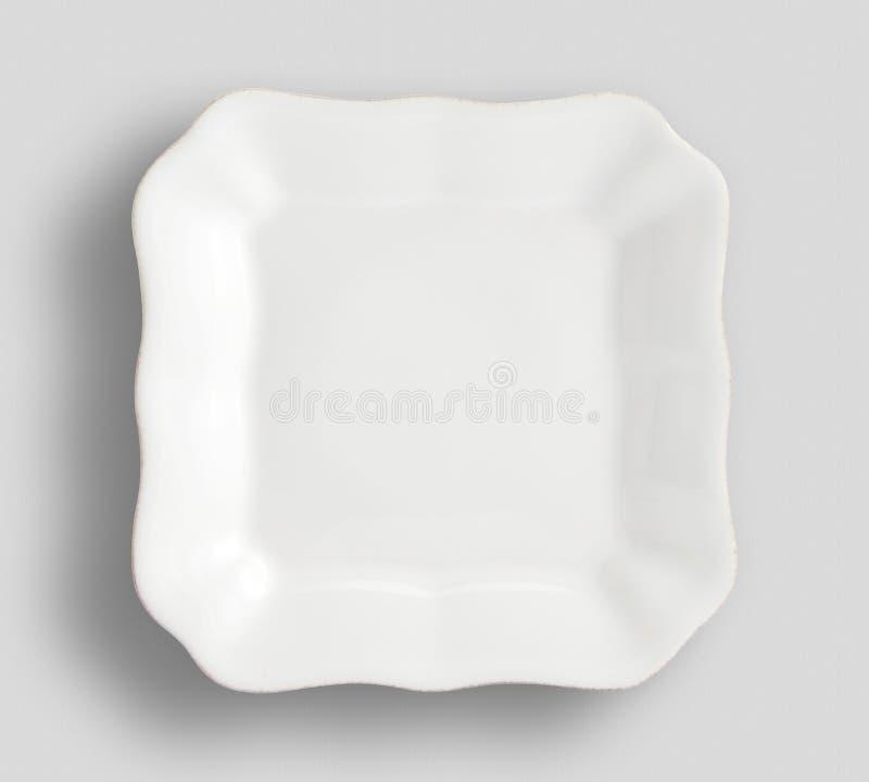 Lege witte ronde plaat op witte achtergrond voor uw ontwerp, Ovale witte lege plaat die op witte achtergrond, Lege witte pla word stock foto