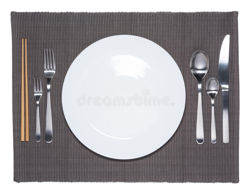 Lege witte schotel, vork, lepel, mes en eetstokjes royalty-vrije stock foto