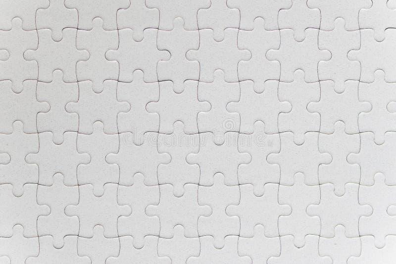 Lege witte voltooide puzzelstukken royalty-vrije stock fotografie
