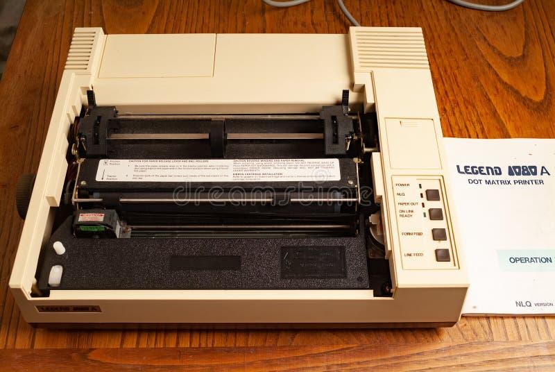 1980s dot matrix printer. Legend 1980s dot matrix printer. kitchen wood table inside a private apartment. Italy Europe stock photos