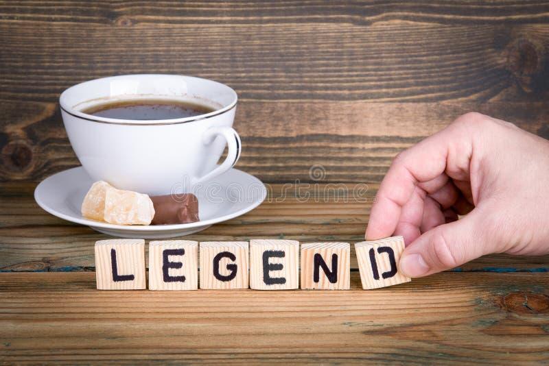legend Träbokstäver på den informativ och kommunikationsbakgrunden för kontorsskrivbord, arkivbilder