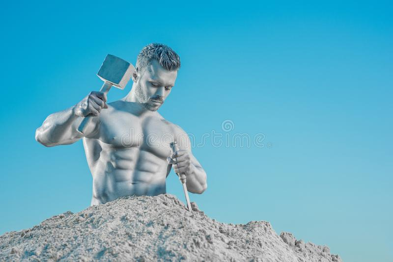 Legendary Atlas creating his perfect body from rock. stock photography