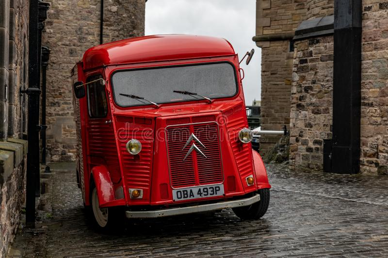 Legendary French Citroen Type H van in interesting red colour at the area of Edinburgh Castle stock images